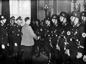 Hitler shakes hands with SS officers wearing Hugo Boss' spring 1937 outfits.