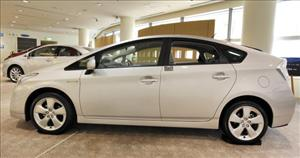 The latest Toyota Prius hybrid vehicle is displayed at the company's showroom in Tokyo on February 5, 2010.