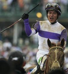 Jockey Mario Gutierrez reacts after riding I'll Have Another to victory in the 138th Kentucky Derby at Churchill Downs, Saturday, May 5, 2012, in Louisville, Ky.
