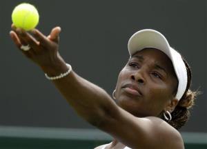Venus Williams tosses the ball to serve to Elena Vesnina at Wimbledon, Monday, June 25, 2012.