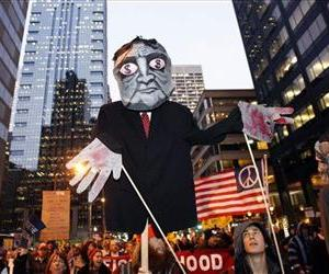 Protestors carrying a street puppet affiliated with Occupy Philly encampment at City Hall march to the Market Street bridge over the Schuylkill River, Nov. 17, 2011 in Philadelphia.