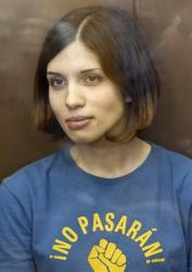 Feminist punk group Pussy Riot member Nadezhda Tolokonnikova sits at a glass cage at a court in Moscow, Russia, Friday, Aug. 17, 2012.