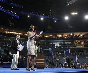 First Lady Michelle Obama gestures as she appears at the podium for a camera test on the stage at the Democratic National Convention in Charlotte, NC, Sept. 3, 2012.