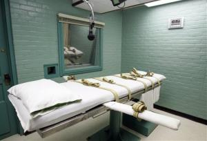 A microphone hangs over the gurney in an execution room.