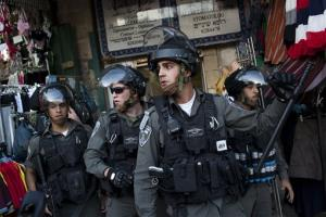 Israeli Border Police take position during clashes in Jerusalem's Old City, Tuesday, April 2, 2013.