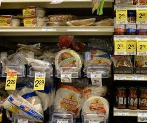 Tortillas and other items are seen in a grocery store in this file photo. Many bread-like products, including tortillas, hot dog buns, and more, contain Azodicarbonamide.