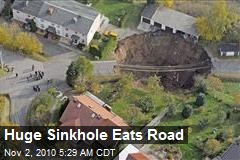 Huge Sinkhole Eats Road
