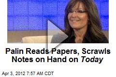 Palin Reads Papers, Scrawls Notes on Hand on Today