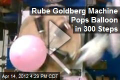 Rube Goldberg Machine Pops Balloon in 300 Steps