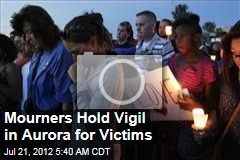 Mourners Hold Vigil in Aurora for Victims