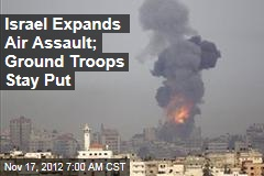 Israel Expands Air Assault; Ground Troops Stay Put