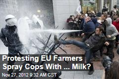 Protesting EU Farmers Spray Cops With ... Milk?