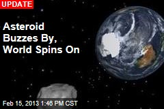 Asteroid Buzzes By, World Spins On
