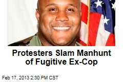 Crowd Protests Manhunt of Fugitive Ex-Cop