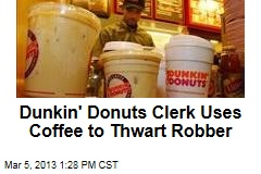 Dunkin&amp;#39; Donuts Clerk Uses Coffee to Thwart Robber