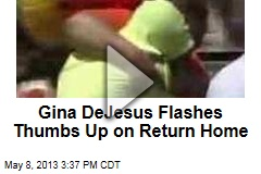 Gina DeJesus Flashes Thumbs Up on Return Home