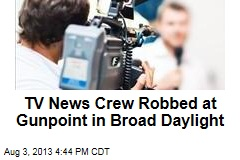 TV News Crew Robbed at Gunpoint in Broad Daylight