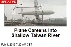 Plane Careens Into Shallow Taiwan River