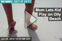 Mom Lets Kid Play on Oily Beach